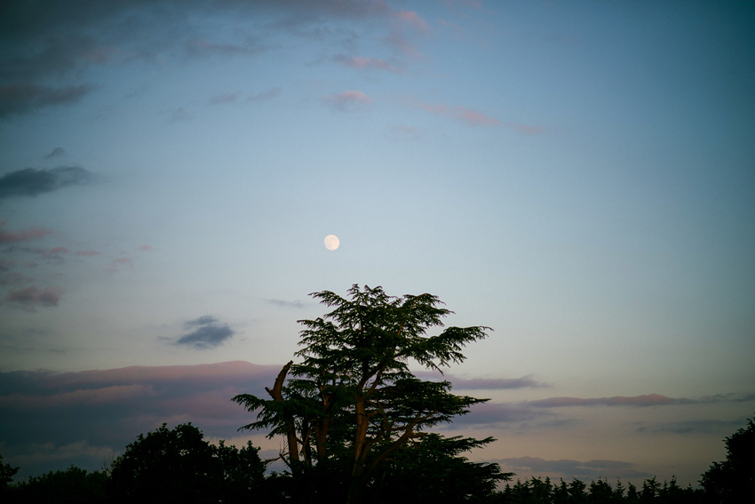 the moon appears over Homme house wedding venue