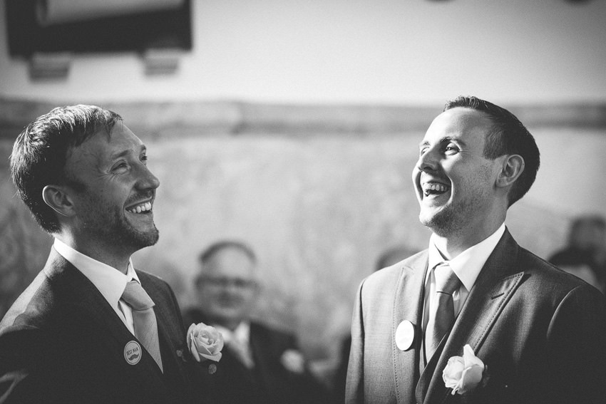 groom and best man sharing a laugh