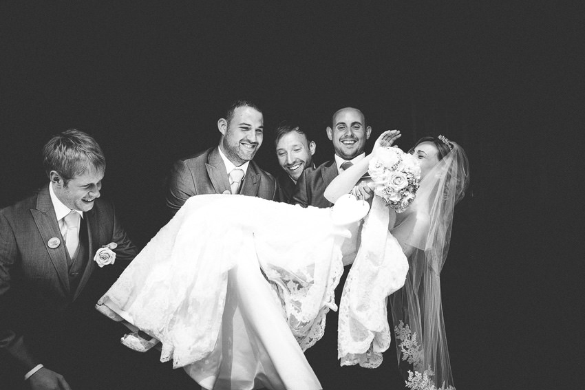 black and white bride being lifted