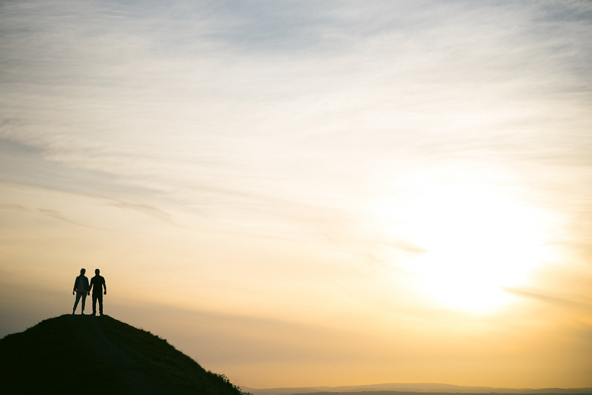 silhouette photograph on a hill