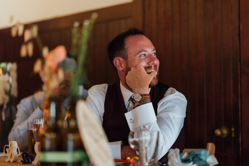 groom laughing at his speech