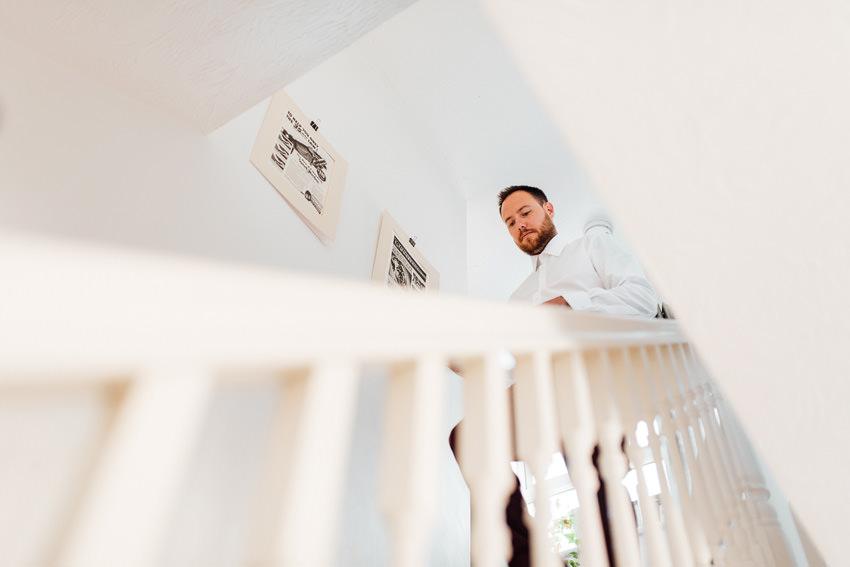 groom making his way downstairs