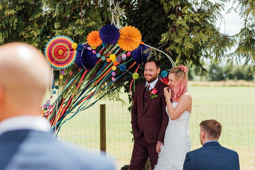 love under the wedding arch