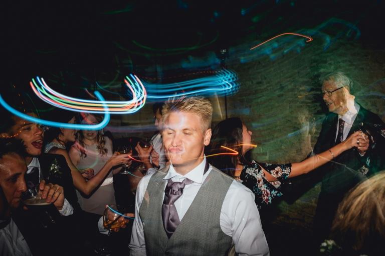 groomsman pouting on dancefloor
