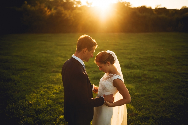 a beautiful wedding couple in the herefordshire countryside at sunset